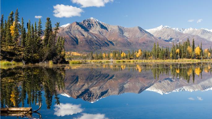 Alaskan mountains reflected in lake